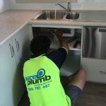 Domestic Plumber completing drain blocked drain repairs in Wollongong