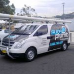 sureplumb emergency van out on a worksite - Plumber Wollongong