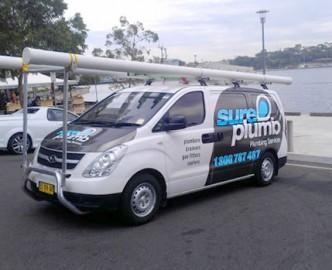 sureplumb emergency plumber van out on a worksite